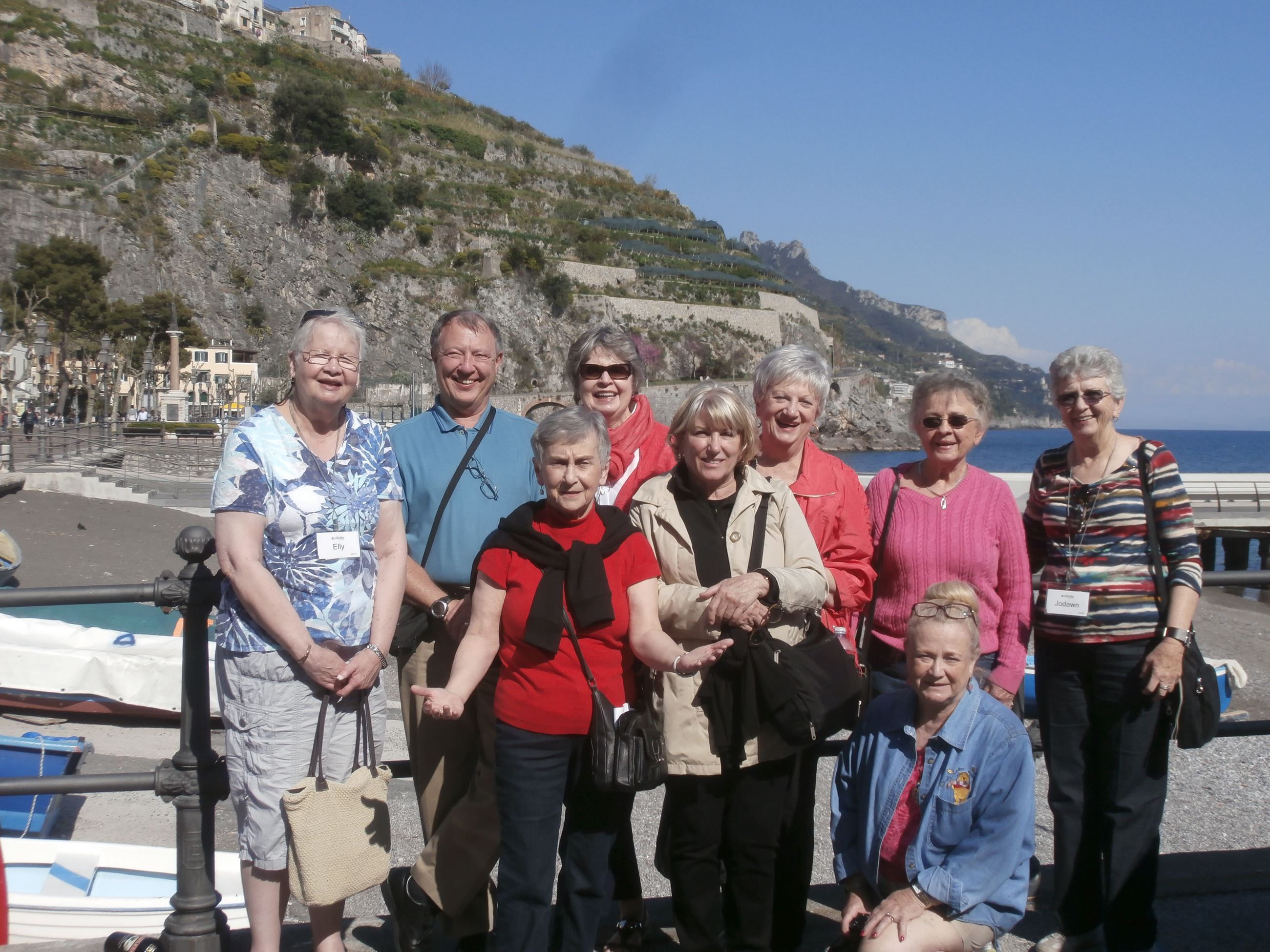 group of travelers posed for a photo in Amalfi, Italy